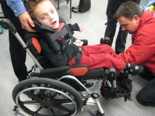 Owen in a Kids Rock wheelchair